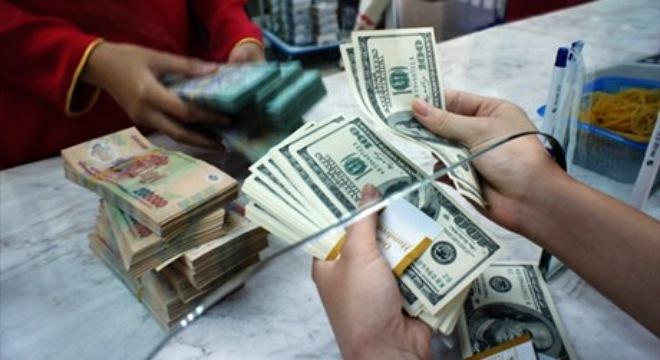 Tỉ giá USD giảm nhẹ sau chuỗi ngày tăng liên tục - 1