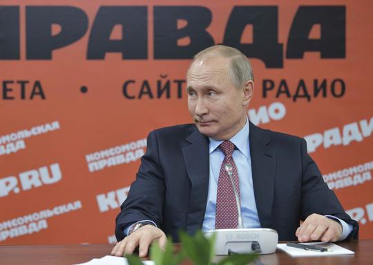 """Tổng thống Putin bất ngờ khen ông Kim Jong-un """"cao tay"""" - 1"""