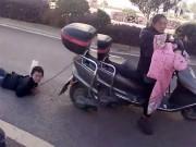 Phẫn nộ bà mẹ trẻ trói tay con kéo lê bằng xe máy khắp phố