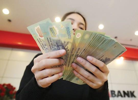Người lao động được doanh nghiệp thưởng tết 20.000 đồng - 1