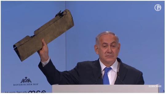 """Thủ tướng Israel đưa mảnh vỡ máy bay tới hội nghị Đức """"vỗ mặt"""" Iran - 1"""