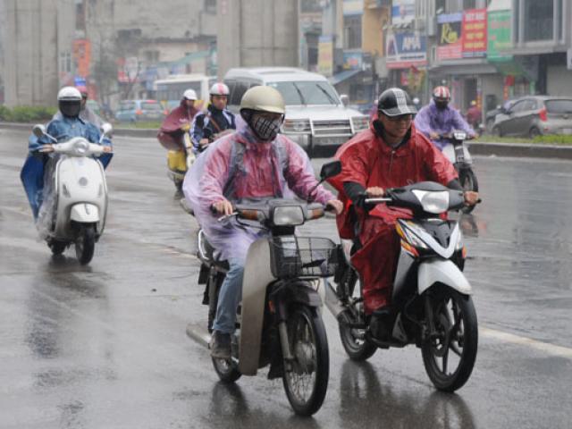 Người dân miền Bắc hứng chịu mưa phùn, nồm ẩm kéo dài