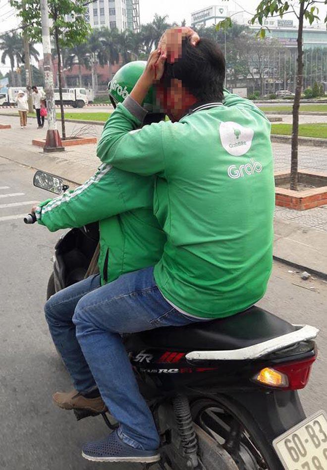 Tài xế xe ôm truyền thống khai lý do đánh tài xế Grabbike gãy xương sườn - 1