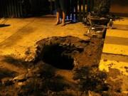 Cảnh sát lật từng nắp cống tìm thanh niên cố thủ nhiều giờ dưới  lòng đất