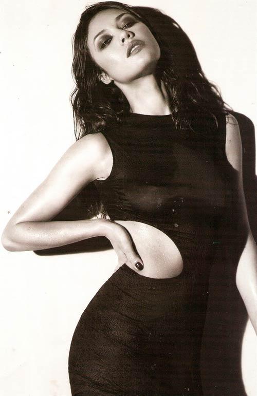 Bond girl Olga Kurylenko sẽ mãi mãi độc thân - 1