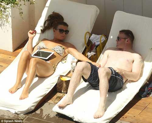 Vợ chồng Rooney du hý giải sầu Euro - 4