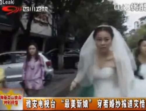 TQ: Cô dâu mặc váy cưới, đưa tin về động đất - 3