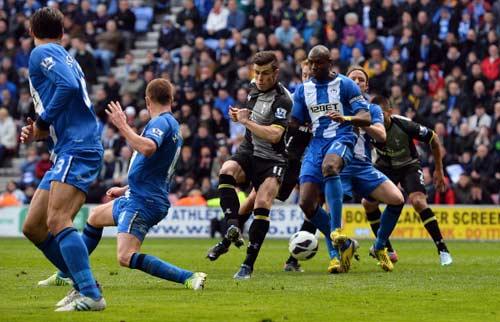Wigan - Tottenham: Trở về mặt đất - 1
