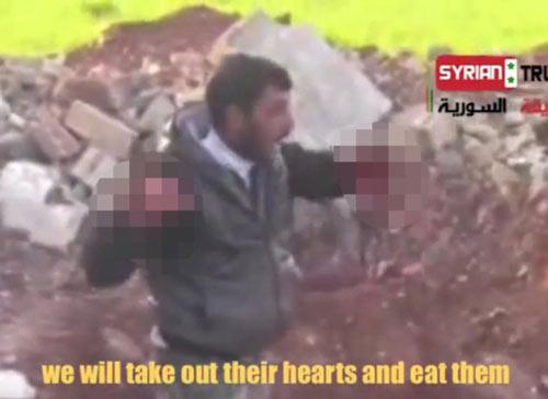 Syria: Ghê rợn video ăn tim xác lính - 3