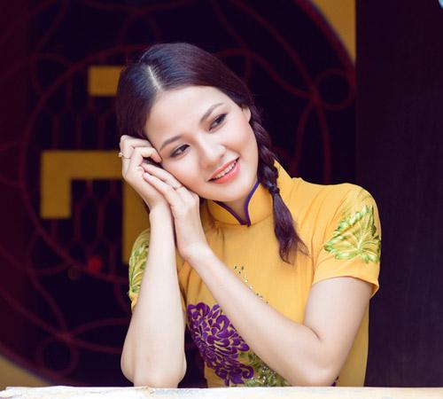 Trần Thị Quỳnh điệu đà áo dài vàng chanh - 11