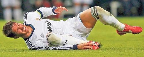 Mou mất ngủ vì chấn thương của Ramos - 1