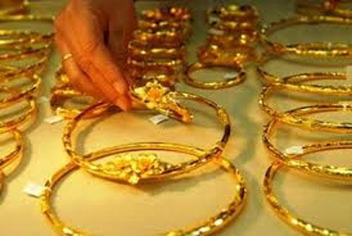 Giá vàng vọt lên 35,60 triệu, USD biến động - 1