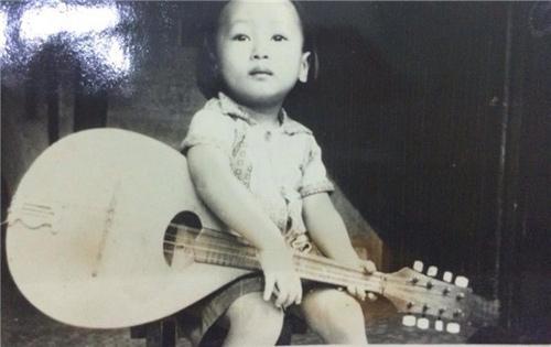 Ảnh thơ ấu dễ thương của sao Việt - 15