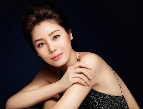 """Điều chưa biết về """"mẹ của Kim Tan"""" - 1"""