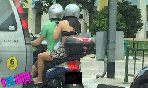 Cô gái châu Á gây sốc vì mặc hở hang dạo phố - 1