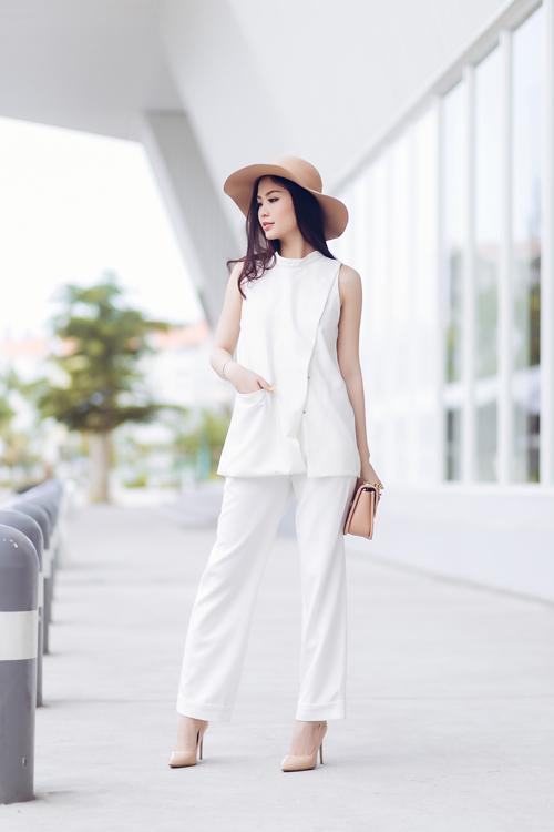 Á hậu Diễm Trang bất ngờ sexy với váy 2 dây - 9