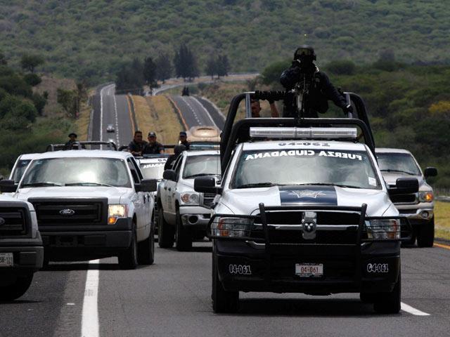 Mexico: Băng ma túy phục kích cảnh sát, 43 người chết - 1