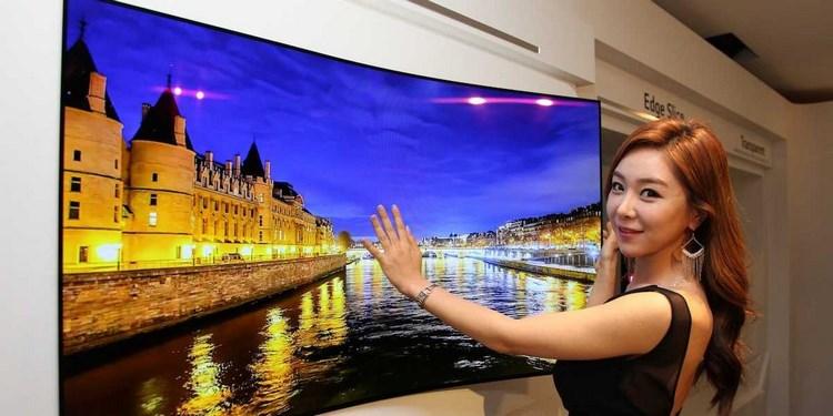 LG khoe TV mới mỏng như giấy dán tường - 1