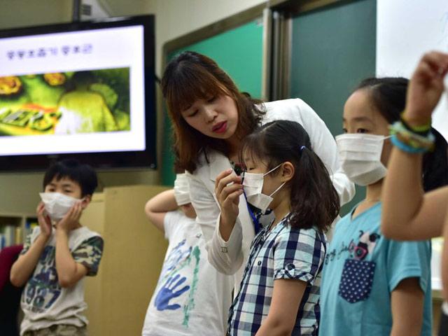 MERS-CoV làm đảo lộn cuộc sống người dân Hàn Quốc - 2
