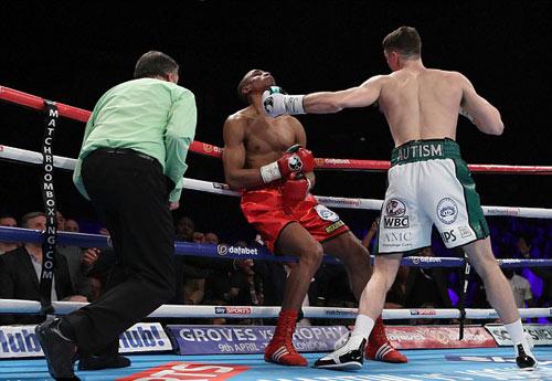 Boxing: Tung seri đấm hạ đối thủ trong 101 giây - 1