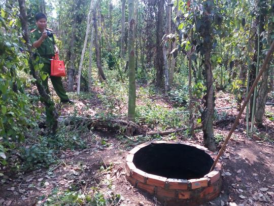 Một phụ nữ chết cháy dưới giếng hoang - 1