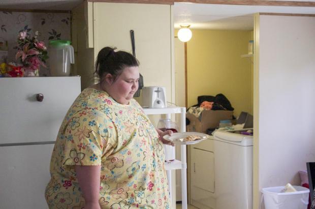 Cuộc sống khó tin của cô gái nặng 312 kg cắt bỏ mỡ thừa - 3