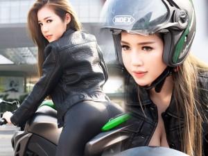 Elly Trần chịu nắng gắt chụp ảnh gợi cảm bên mô tô