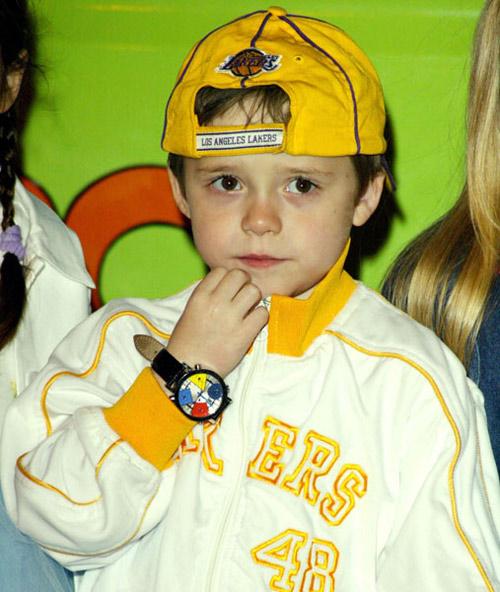Con trai David Beckham ngày càng điển trai giống bố - 6