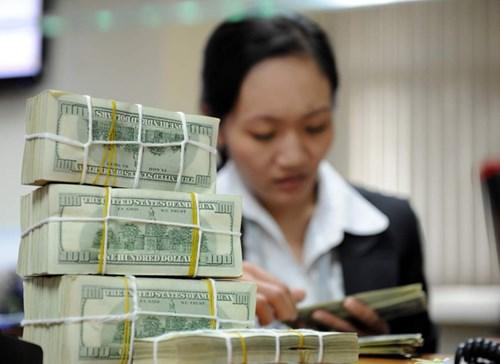 Người Việt gửi bao nhiêu tiền ở nước ngoài? - 1