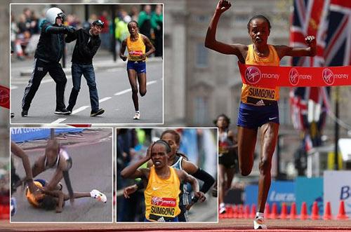 Bị ngã rồi bị uy hiếp, VĐV vẫn vô địch marathon - 1