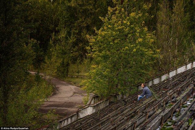 Ảnh: Dân chúng trở lại khu thảm họa Chernobyl sau 30 năm - 8