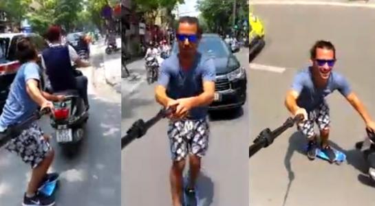 Trai Tây bám xe máy trượt patin gây xôn xao ở Hà Nội - 1