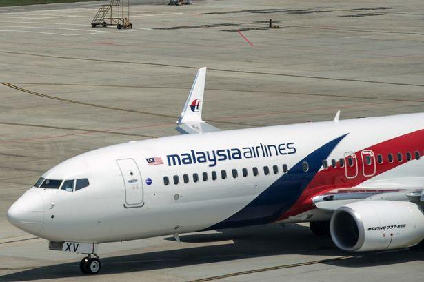 Thêm 2 mảnh vỡ gần như chắc chắn của MH370 - 1