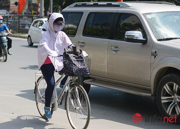 Người Hà Nội đối mặt với đợt nắng nóng nhất từ đầu hè - 10
