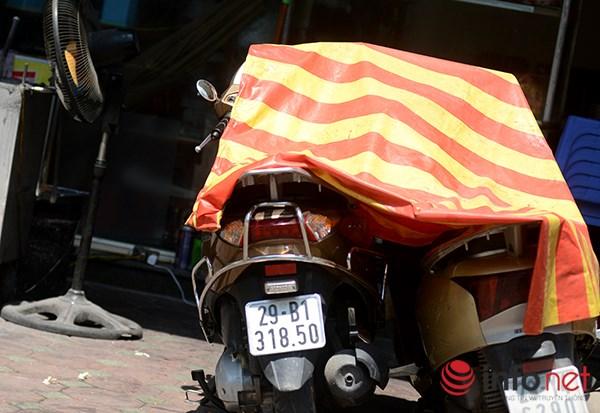 Người Hà Nội đối mặt với đợt nắng nóng nhất từ đầu hè - 7