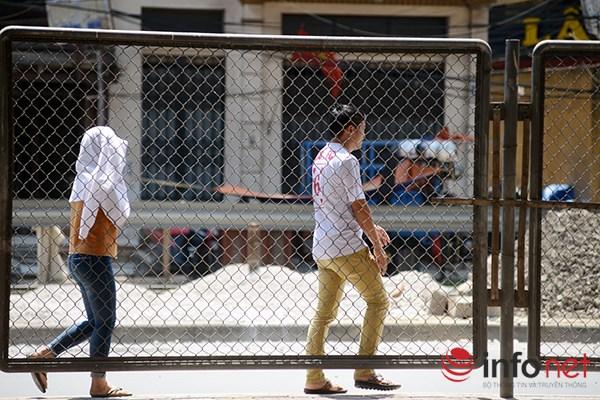 Người Hà Nội đối mặt với đợt nắng nóng nhất từ đầu hè - 9