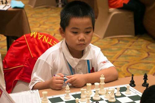Kỳ thủ Việt 8 tuổi gây sốt Đông Nam Á - 1