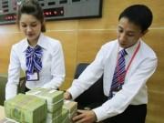 Tài chính - Bất động sản - Có nên dỡ trần lãi suất 0% tiền gửi USD?
