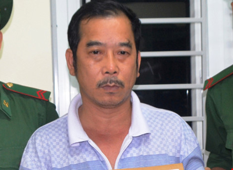Đóng giả khách du lịch mang 4 bánh heroin từ Lào về VN - 1