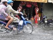 Tin tức trong ngày - Mưa trái mùa, người SG tổ chức lễ cưới trong nước ngập