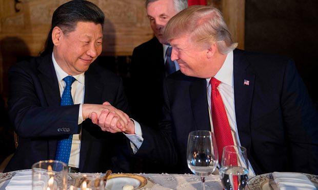Trump có ý gì khi phóng tên lửa ngay sau ăn với ông Tập? - 1