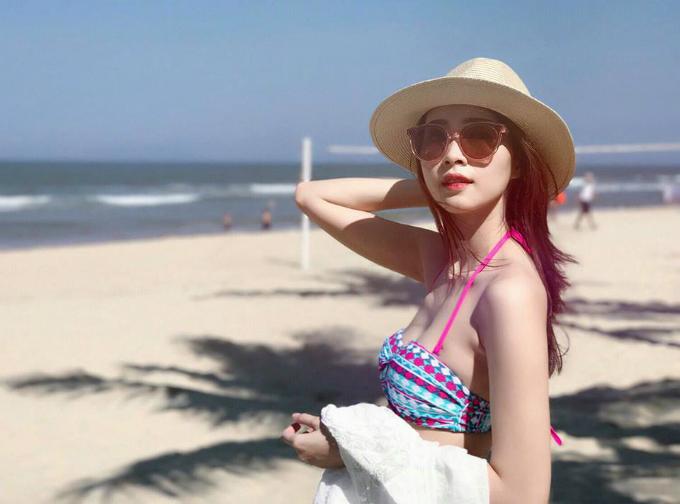 Hoa hậu Thu Thảo tung ảnh áo tắm hiếm hoi kỳ nghỉ lễ - 1