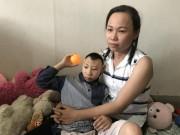 Tin tức trong ngày - Người cha nuôi 2 con bị bại não xin lỗi các mạnh thường quân