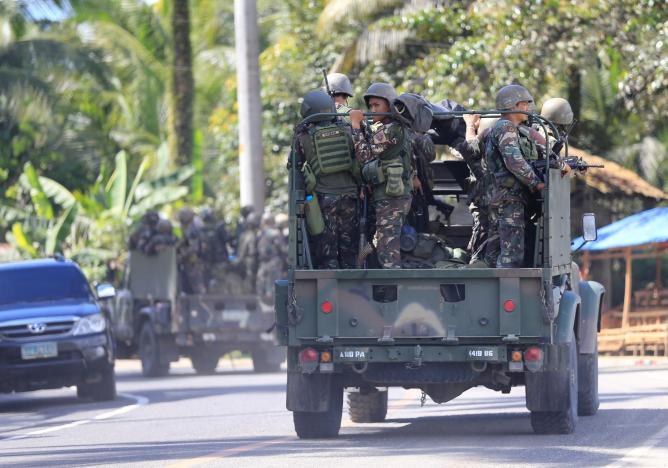 IS chặt đầu cảnh sát Philippines: Đang giao tranh ác liệt - 2