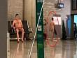 Hành khách khỏa thân bí ẩn, thư thái đi lại trong sân bay