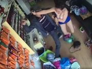 """An ninh Xã hội - Clip: Chủ tiệm nail xinh đẹp đánh tên cướp có súng chạy """"mất dép"""""""