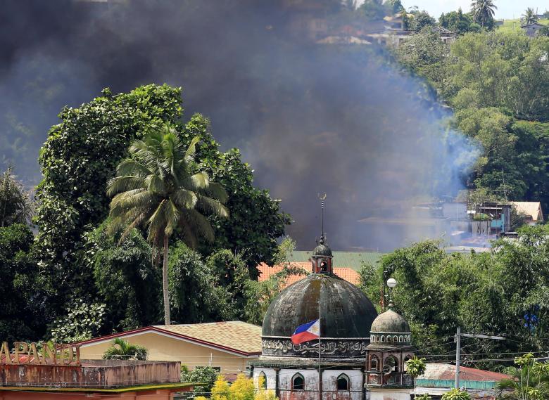 Chạy trốn lính Philippines, IS bỏ lại đống tiền 36 tỷ đồng - 1