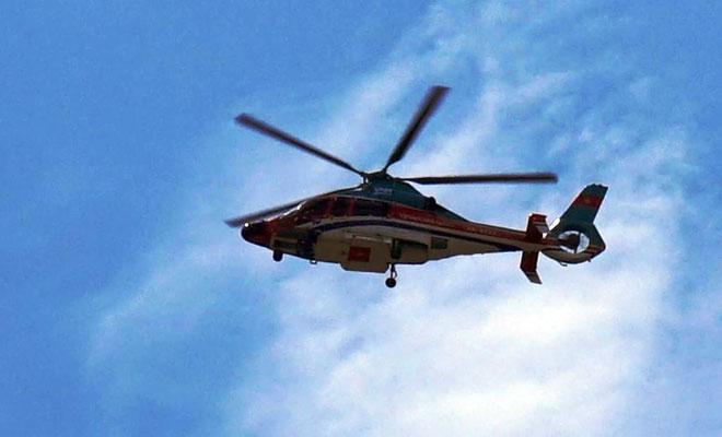 Người dân ngỡ ngàng thấy trực thăng xuất hiện trên nóc nhà ở SG - 1
