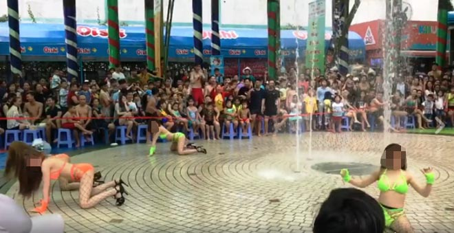 Phạt nặng vụ múa bikini uốn éo trước mặt trẻ ở Sài Gòn - 1