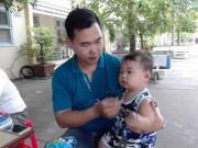 Tin tức trong ngày - Chồng bế con 9 tháng tuổi theo vợ đi thi